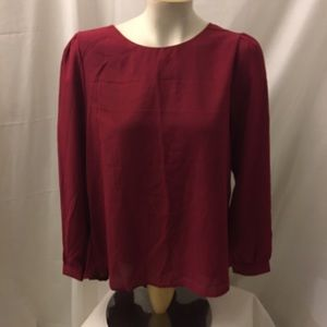 Women's red sheer blouse top with pleated back